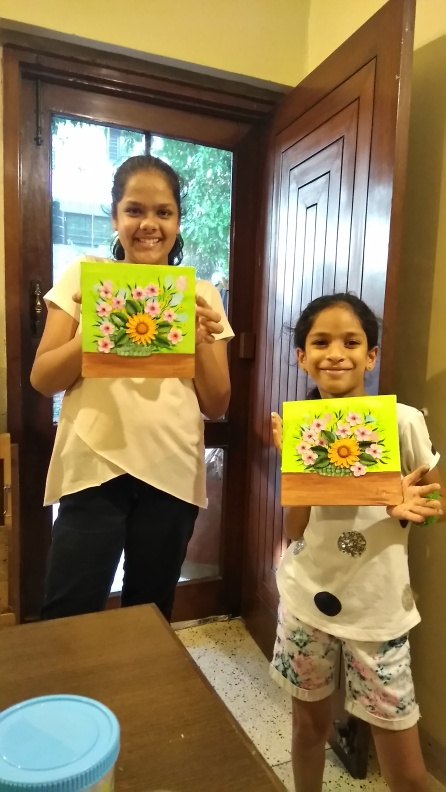 Anvi and Sanchi with their first clay paintings at Gunjan Clay Art Classes